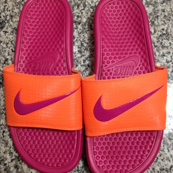 364008fc9a9b5 Pink orange Nike Benassi Swoosh slides. M 57d33136bcd4a72fe00146fb