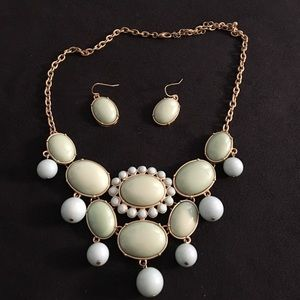 Pale green statement necklace and earrings