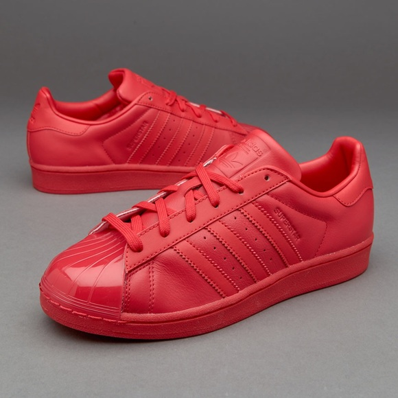 Red superstar woman adidas sneakers