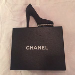 Gorgeous Chanel black sued with leather tip.