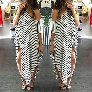 Dresses & Skirts - Black and white Asymmetric dress DR104