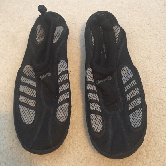 Oxide - Black and white water shoes from Jamie's closet on Poshmark