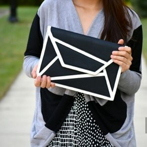 Handbags - Black and white clutch