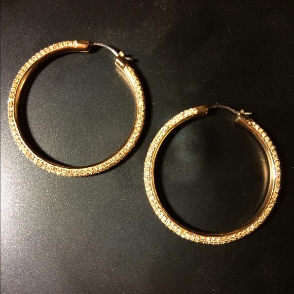 b7d2096f9295d Rose gold Michael Kors hoop earrings. M 57d5a037522b455ba50011ff