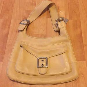 Yellow Coach shoulder bag.