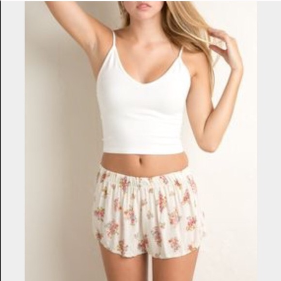 32% off Brandy Melville Pants - Cream floral flowy shorts from ...