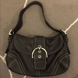 Coach leather purse with monogram print inside