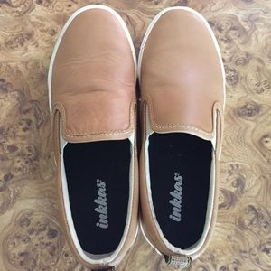 Pair of Inkkas unisex sneakers