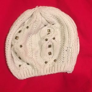 Cream knitted beanie with gold studs