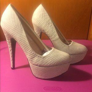 NIB Qupid taupe platform heels.