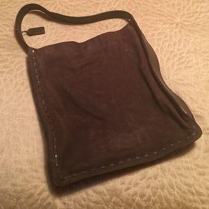 Brown suede Coach handbag.