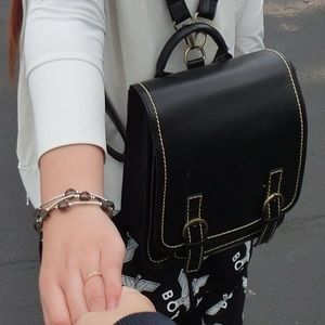 75% off Handbags - Black hard leather backpack. from Blackcandy's ...
