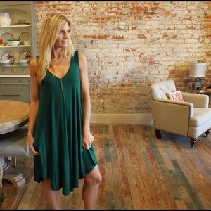 Green asymmetrical v neck dress with pockets
