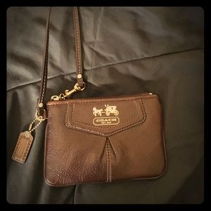 Brown leather Coach wristlet.