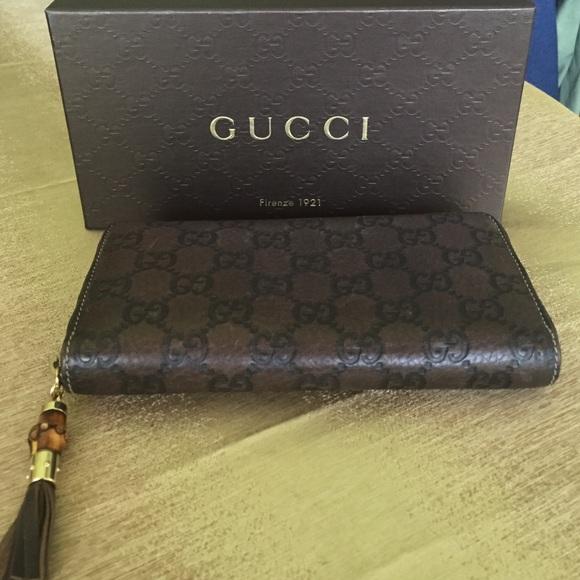 2239abb3bc54a0 Gucci Handbags - Authentic Gucci bamboo tassel wallet.