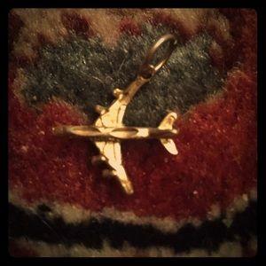Golden airplane charm!