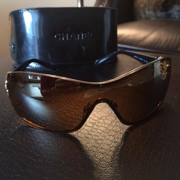 17de215f54 CHANEL Accessories - Chanel Gold rimmed sunglasses. Black arms