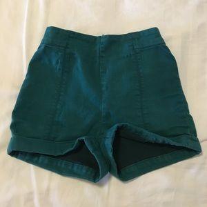 High rise green short shorts.
