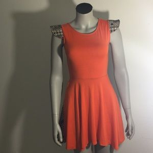 Dresses & Skirts - Assymetrical hem orange and print dress