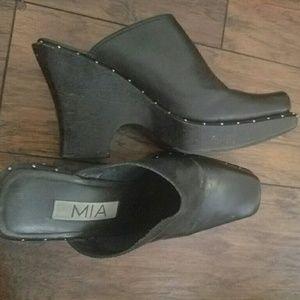 Black clog like shoe