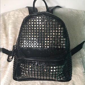 Embossed croc grommet backpack!