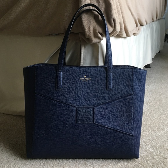 kate spade Handbags - Navy blue pebbled leather tote with bow detail