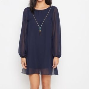 Navy shift dress with arrow necklace