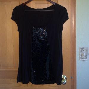 Black cotton top with sequins in center.