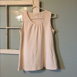 Cream sleeveless shirt