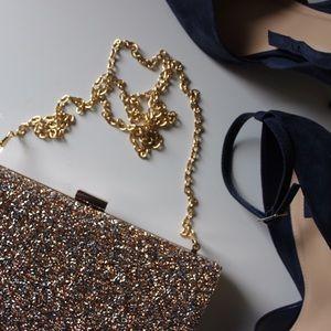 ALDO gold+bronze encrusted clutch