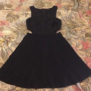 Bebe medium black dress. Cut out sides.