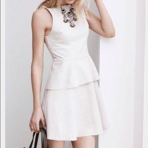 Raw edge peplum dress.
