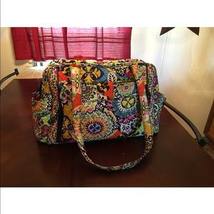 Vera Bradley diaper bag w/fold-out changing pad.