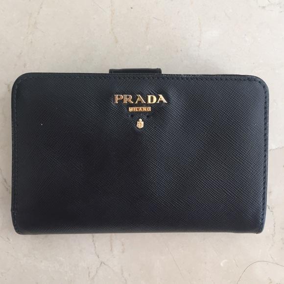 3f9540a54ddf Prada Bags | Saffiano Triangle Bifold Tab Wallet Black | Poshmark