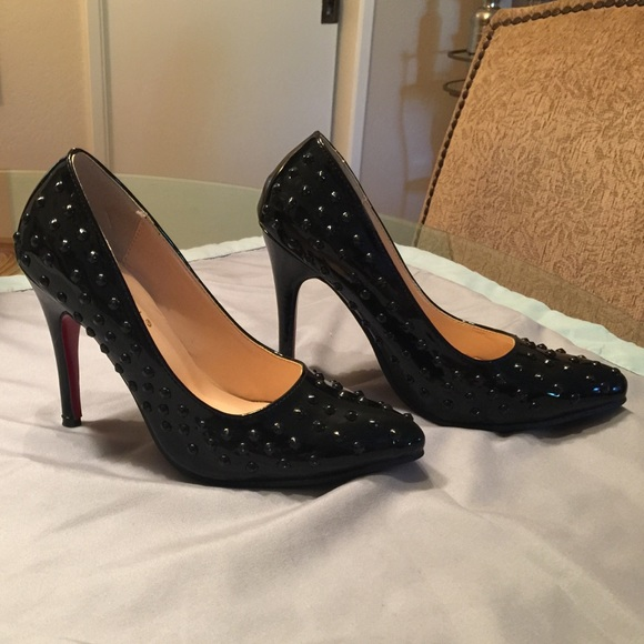 9bf014025cb Black patent leather studded red bottom heels
