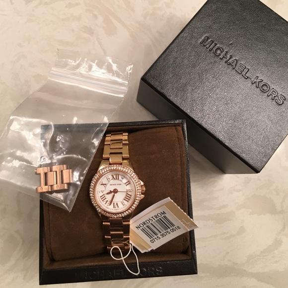 55164ec3f10d Michael Kors mini Camille bezel rose gold watch. M 57e352b15a49d0f1d70210f5