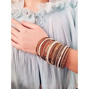 Stack of gold bangles