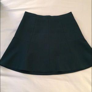 Dark green fluted mini skirt