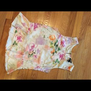 Gorgeous floral peplum top size 6