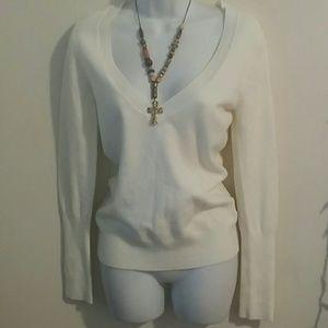 Cream colored cute sweater, size medium.