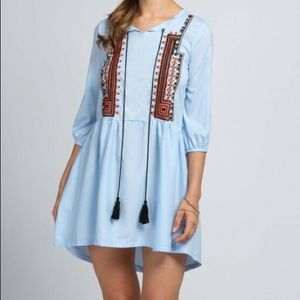 Embroidered mini dress or tunic.