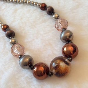 new directions Jewelry - • copper/silver ANIMAL print necklace •
