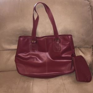 Burgundy tote bag with small cosmetic bag.