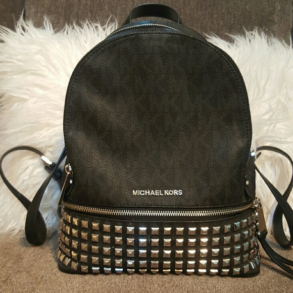 717cf1261180 ... Rhea Small Studded Leather Backpack. M_57e847855c12f8ebdf056bd5