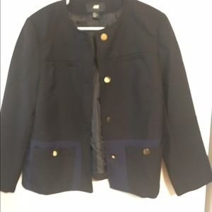 Blazer with navy pockets and gold button details.