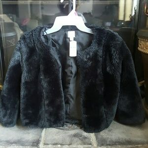 Faux fur jacket new with tags never worn.