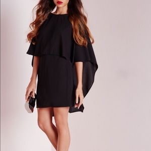 Missguided Dresses & Skirts - New WITH tags. Beautiful black cape dress