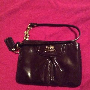 Dark purple patent leather coach wristlet