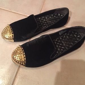 Black velvet flats with gold spikes on the front