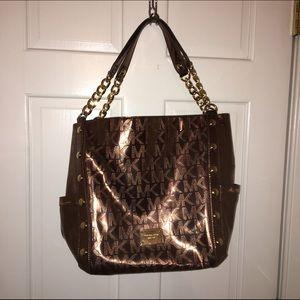Michael Kors Handbags - Large MK copper/metallic tote bag, looks new!
